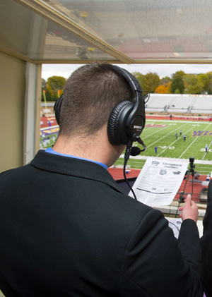 student doing play-by-play of football game