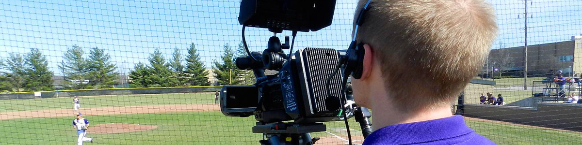 student shooting video of baseball game