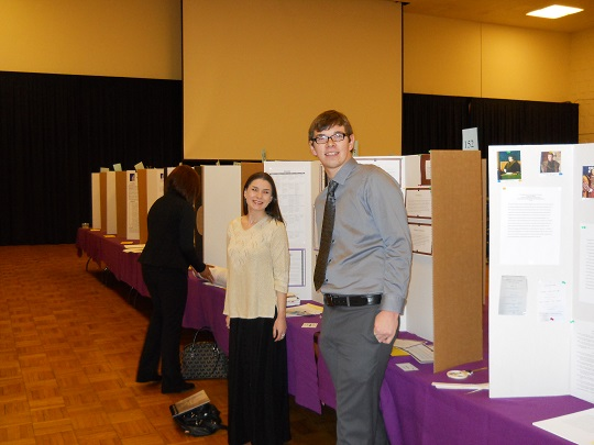 Students presenting historical research at URD