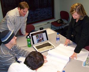 Economics students working with professor