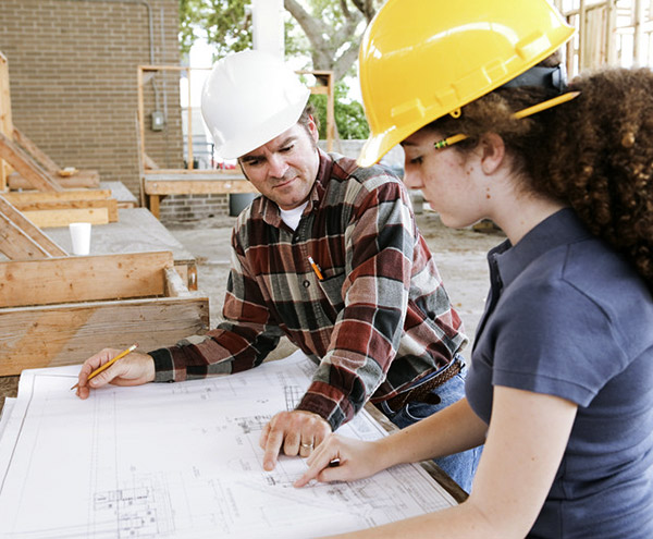 construction workers reviewing floor plans