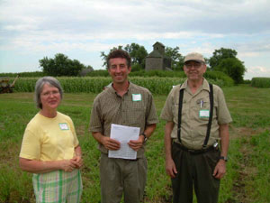 Dr. Joel Gruver with Doris and Joe Foust-owners of the Allison Farm