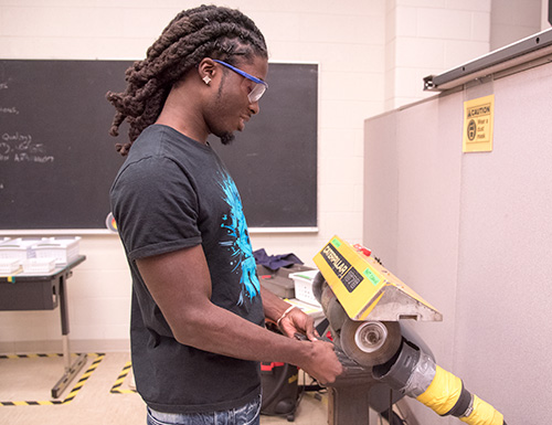 student working with a machine