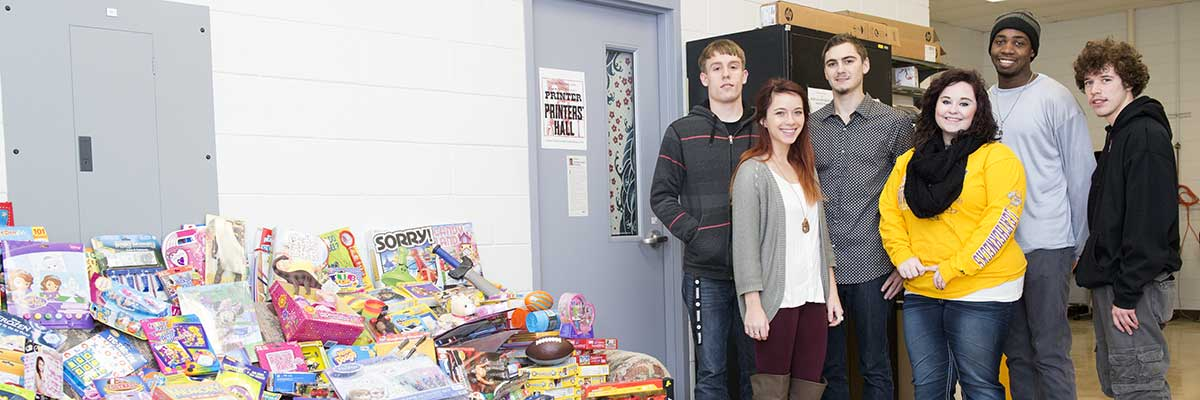 Gcom students with toys for toy drive