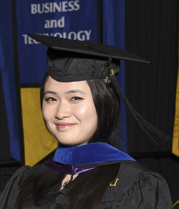 MBA student in cap and gown
