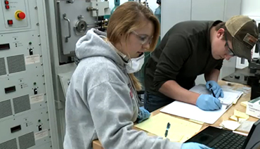 students working in QC manufacturing lab