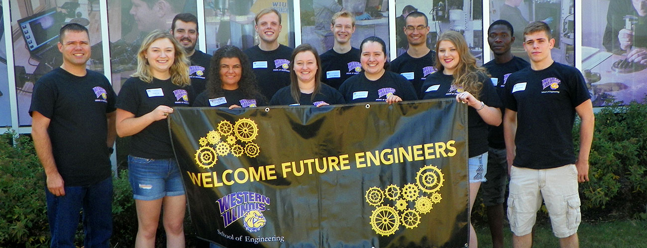 Students Holdina a Welcome Future Engineers Banners
