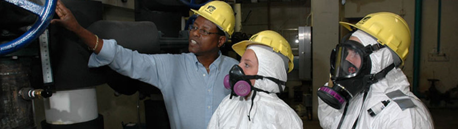 Faculty member with studetns wearing protective gear