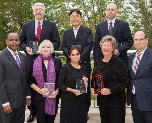 2014 Provost's Award Recipients: front row, l-r, President Jack Thomas, Cathy McMillan, Bhavneet Walia, Kate Pohlpeter, Provost Ken Hawkinson; back row, l-r, Vincent Auger, Seung Won Yoon, Brian Peer. Not pictured, Sarah Haynes.