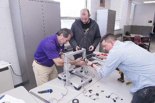 WIU Engineering Technology Professor Rafael Obregon (left) works with Robert Buckley, computer science graduate student, and Rob Martin (of Open Source Classroom, LLC) to put together a new 3-D printer for Western.