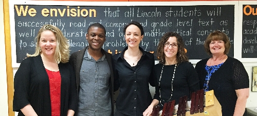 Pictured, from left, are School of Music Interim Director Tammie Walker, senior music major Paul Rich, of Greensboro (NC), music graduate student Amy Broadbent, of Lansing (IL), music graduate student Diana Kurasz, of Macomb, and Lincoln School Principal Kimberly Gillam.