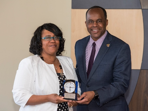 President Jack Thomas presented EOA Director Andrea Henderson the 2017 Cathy O'Neill Couza Award for Outstanding Leadership in Diversity.