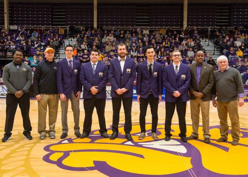 Pictured, from left, are Director of Sports Broadcasting Quinton Parker, Broadcasting and Journalism Chair William ''Buzz'' Hoon, WIU student broadcasters Michael Harms, Michael Dion, Zachary Martin, William Turkington and Collin Miller, WIU President Jack Thomas and College of Fine Arts and Communication (COFAC) Dean Billy Clow.