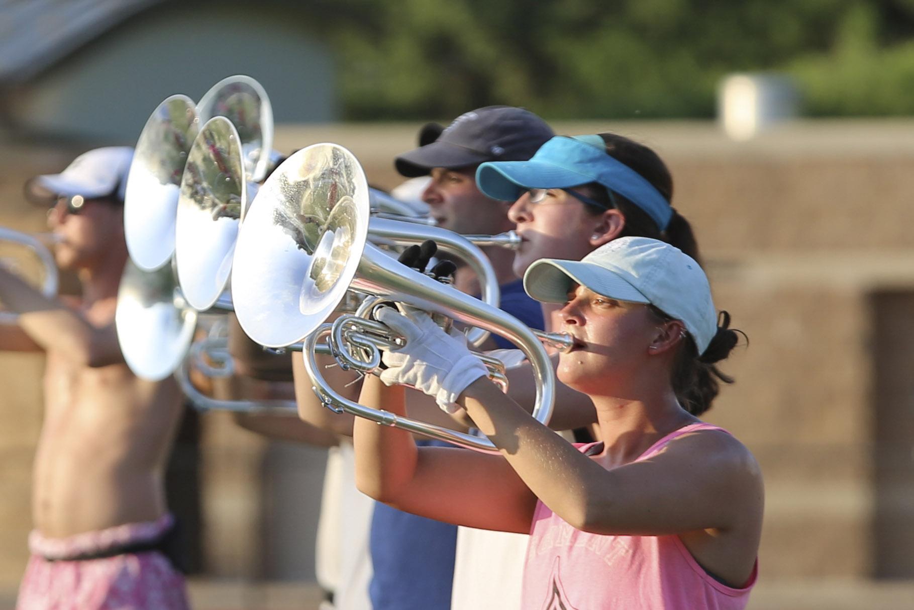 5e0503227ebc43 MACOMB, IL – The world champion Phantom Regiment Drum and Bugle Corps began  its summer training camp on the campus of Western Illinois University  Sunday, ...