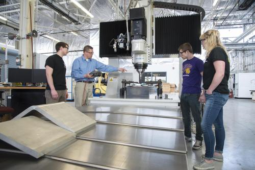 In this Spring 2018 photo, WIU-QC Engineering student-interns learn about equipment at the Quad Cities Manufacturing lab located on the Rock Island Arsenal.