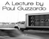 Image of a blurry car in the foreground and a moving truck in the background with the text A Lecture by Paul Guzzardo.