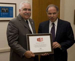 President Al Goldfarb and Distance Learning and Outreach Director Richard Carter holding