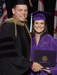 Marissa Brungraber receiving diploma from RPTA chair and professor Dale Adkins at WIU Fall 2009 Commencement ceremony.