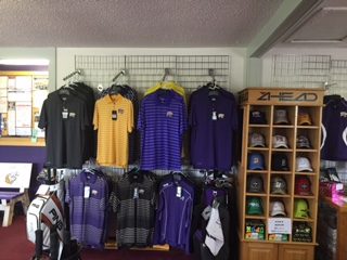Photo of shirts, hats, ect. in WIU golf shop.