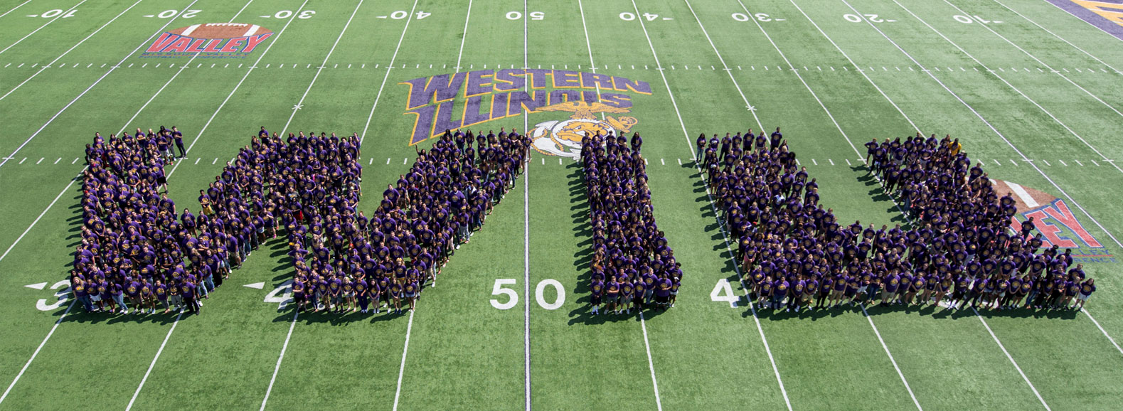2017 Freshman Class standing in the shape of the letters WIU on the football field