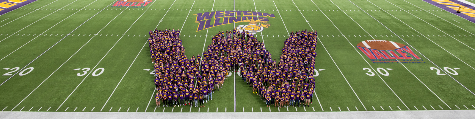2019 fall class on the football field in the shape of a W