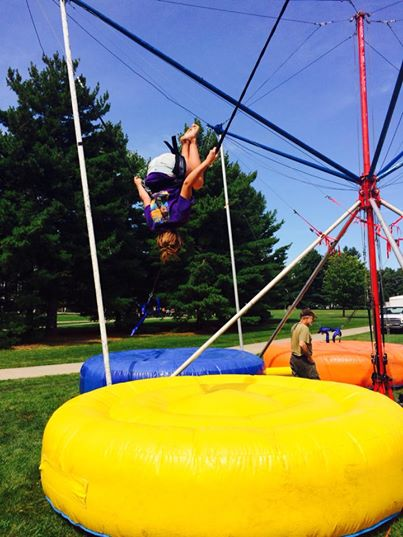 A WIU student on a bungee trampoline at the Homecoming kickoff event.