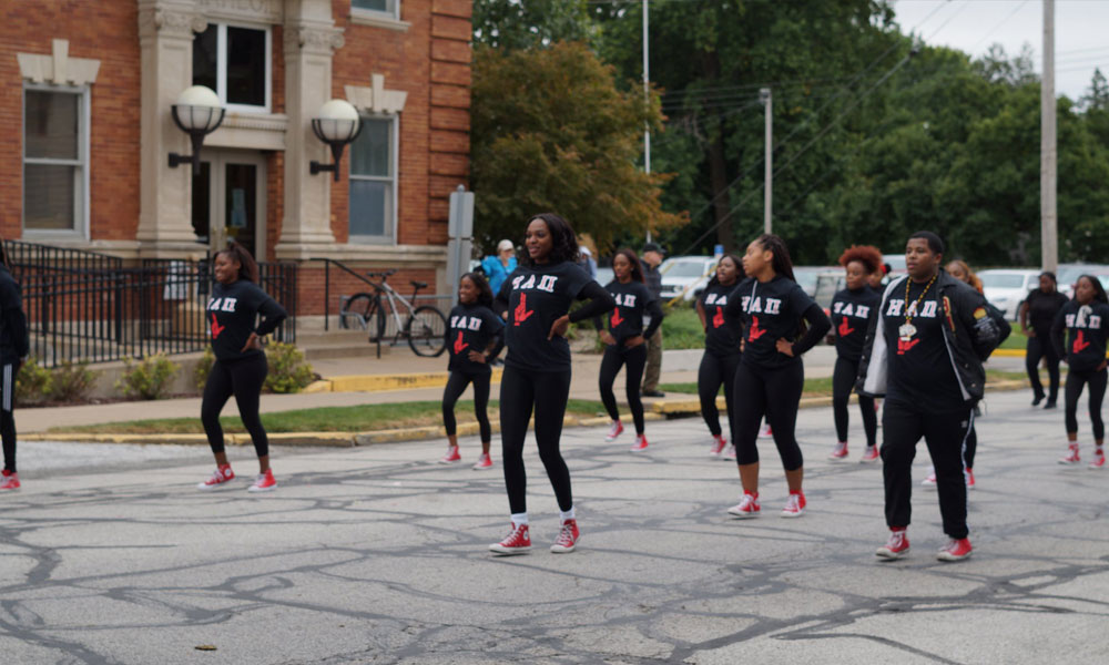 HA2: House Arrest 2 dancing down the parade route for 2018 Homecoming Parade Route