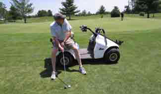 Golfing from the accessible golf cart